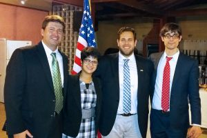 Travis Knoll at right, with other interns at an Embassy-sponsored party