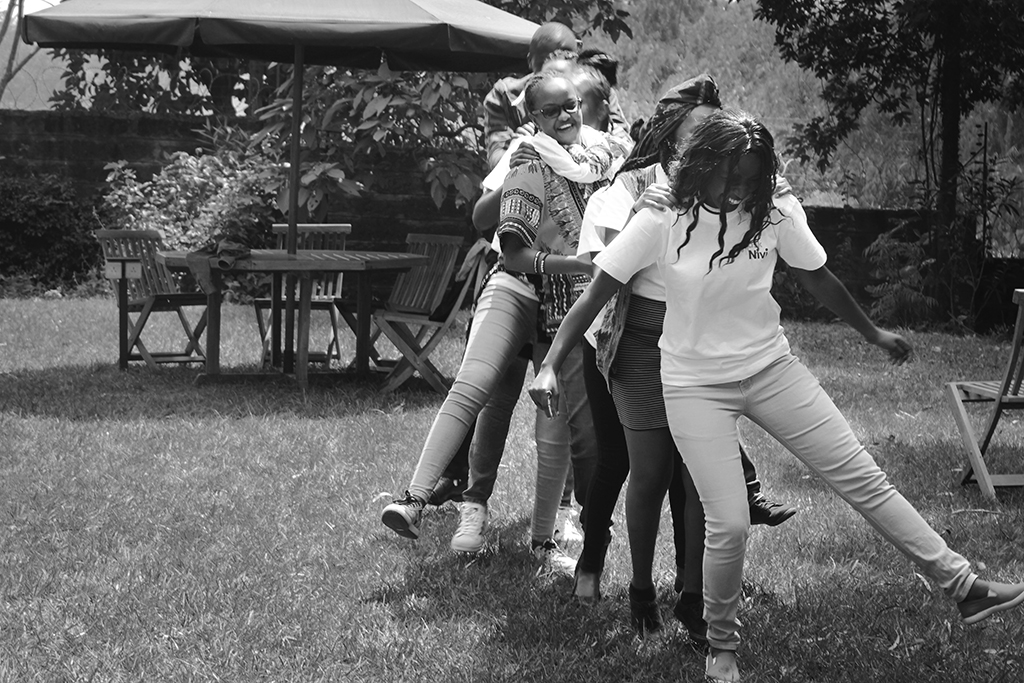 "Photo by Stephanie Jaffe: University students in Nairobi, Kenya, dance in front of each other to learn to ""be comfortable with being uncomfortable,"" a crucial skill for talking to peers or strangers about askNivi, a digital platform that provides free contraceptive screenings and information on sexual and reproductive health."