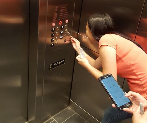 Bass Connections team members sampling in an elevator