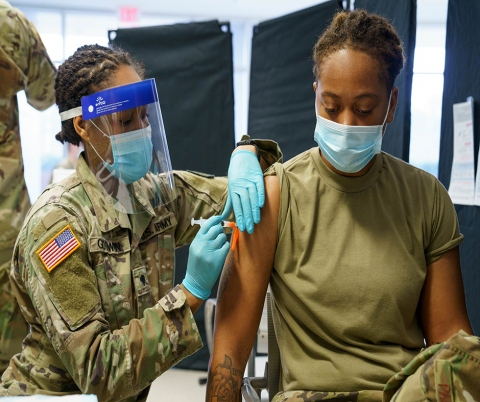 Airman 1st Class Trinity Packer joins members of the North Carolina National Guard receiving COVID-19 inoculations.