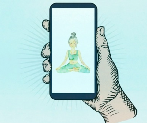 Hand holding phone with image of person meditating