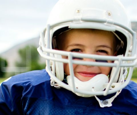 Youth athlete wearing helmet