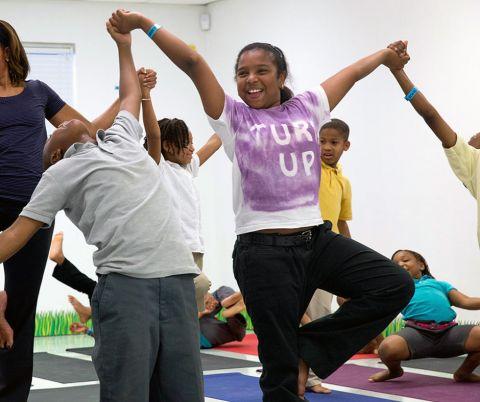 Children in a class doing yoga