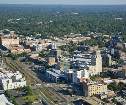 Aerial view of downtown Durham and American Tobacco campus, with Duke Clinical Research Institute at right