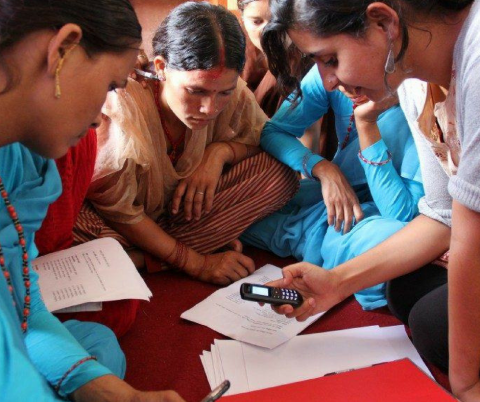 Women using a mobile phone for healthcare purposes