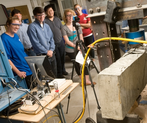Engineering students test concrete beams during a lab class at Hudson Hall on March 26, 2009.