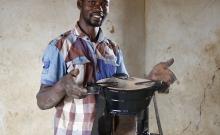 Man holding stove.